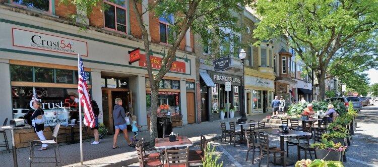 Restaurants in downtown Holland transform parking spaces into areas for patio seating.