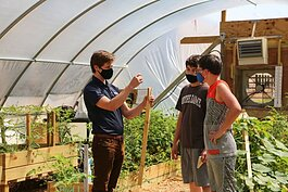 Gentex engineer Elliot Busta volunteers weekly at the Holland Middle School greenhouse, teaching students about STEM.