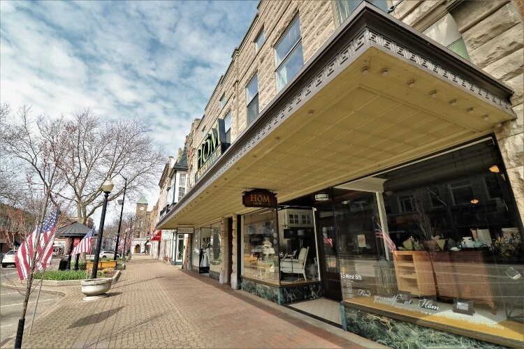 With shops and restaurants closed, the sidewalks in downtown Holland lack the usual hustle and bustle of a springtime Saturday.