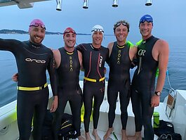 The 'Epic Swim' team practices a night swim on Lake Michigan. Pictured from left to right are Nick Hobson, Todd Suttor, Matt Smith, Jon Ornée and Jeremy Sall. (Missing from the photo is team member Dave Ornée.)