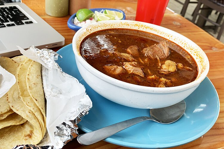 A hot bowl of pozole from El Toro Bravo
