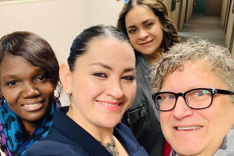 WMHCC's Ana Jose, sisters Marielena and Salvia Cano, and Tommy Allen post WGVU radio interview selfie.