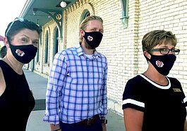 "Spring Lake DDA Director Angela Stanford-Butler, Grand Haven Main Street Executive Director Jeremy Swiftney and Ferrysburg Mayor Rebecca Hopp wear their ""love of community"" masks."