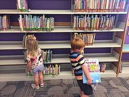 Violet and Quinn Tunison were excited to back at the Howard Miller Public Library in Zeeland.