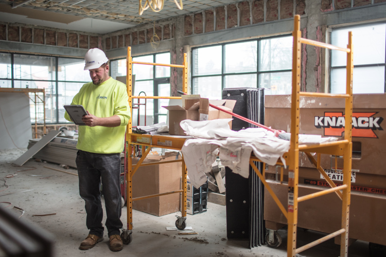 Jamie Baltruczak uses a tablet to manage his jobsite for Orion Construction.