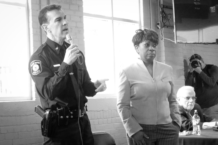Chief Rahinsky and Mari Beth Jelks speak about the traffic stop study during a public meeting.