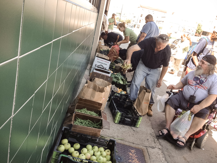 Heartside residents enjoy food from the Heartside Gleaning Initiative.