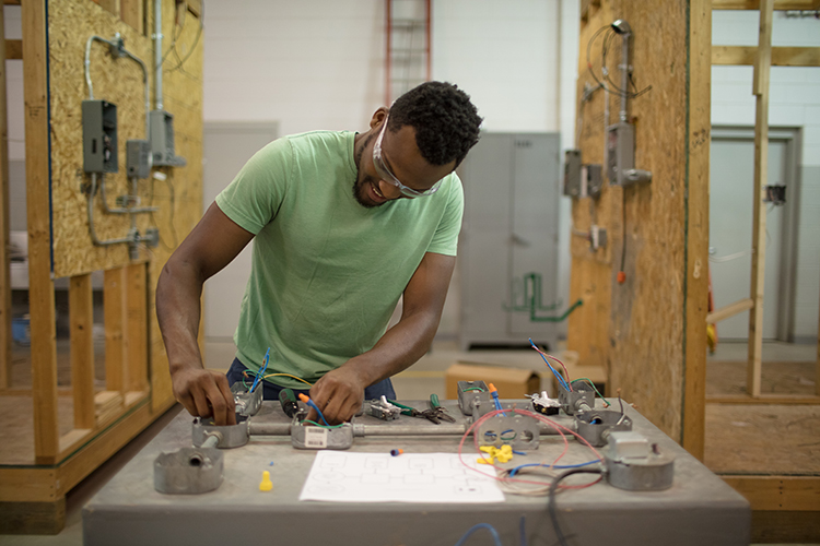 Chris Kellie learns skilled electrician work at GRCC.
