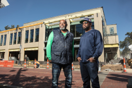 Lewis Williams, left, and  Darel Ross II in front of the future site of Forty Acres.