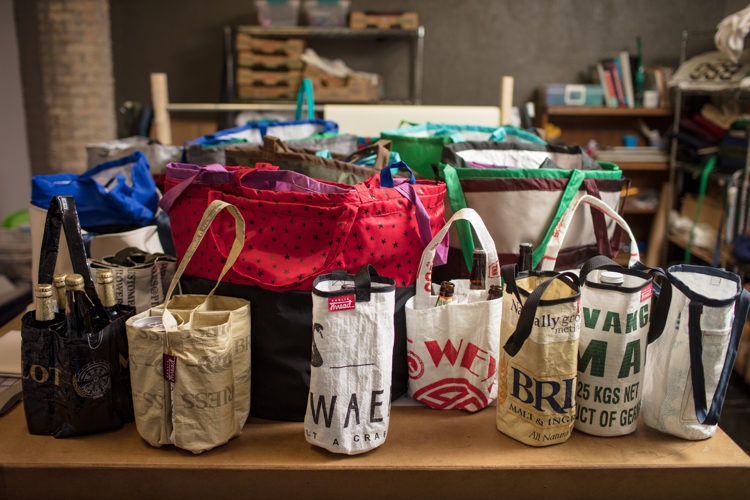 Discarded materials from brewing become transformed into useful bags.