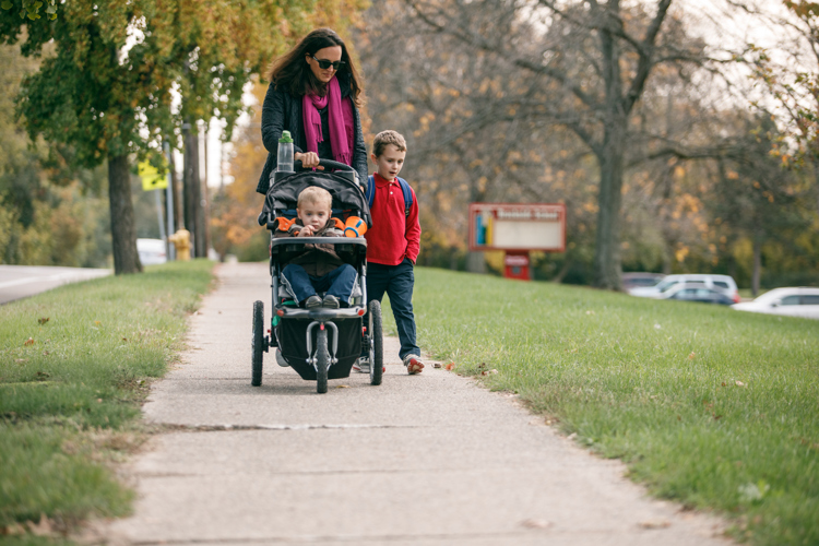 Meryl Herr and her sons Jeremiah and Caleb walk home from school.