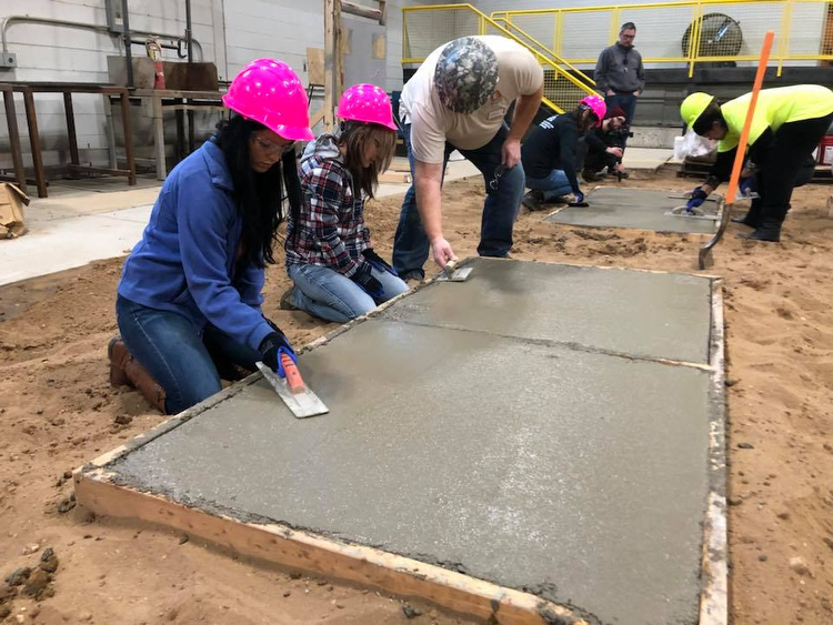 Students learn to work with concrete.