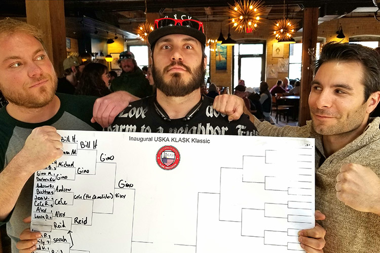 Klask Reid Warber, Kevin (World Champ), and Geno Mallo. Reid & Geno played at Odd Side Ales and secured slits at the US Klask Championships.