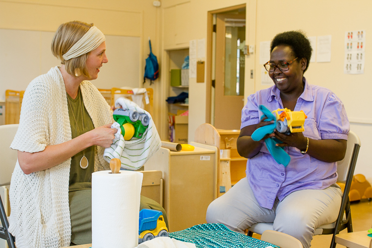 Susan Kragt, left, works with Basalissa Uwera at the Refugee Education Center.