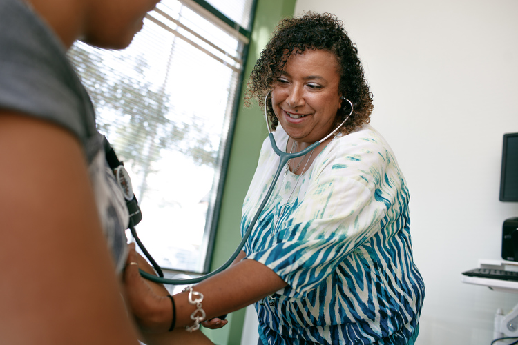 Dawn Cordero-Reyes RN checks blood pressure at the NHBP Clinic in Grand Rapids.