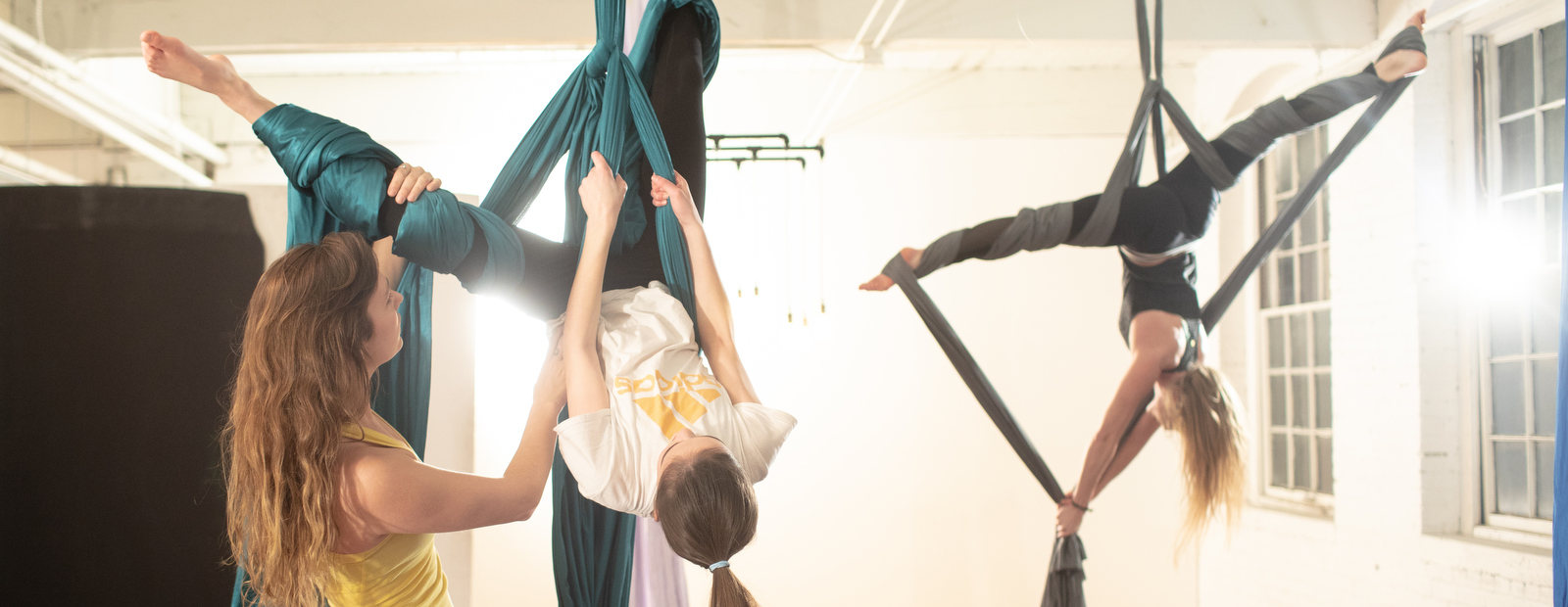 Students learn to exercise and perform in the air using silks at Zeal Aerial Fitness.