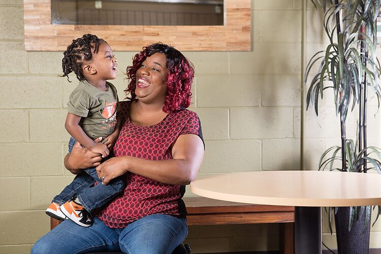 Shontaze Jones and her son E'Daniel Smith Jr. have improved their lives with help from Community Rebuilders.