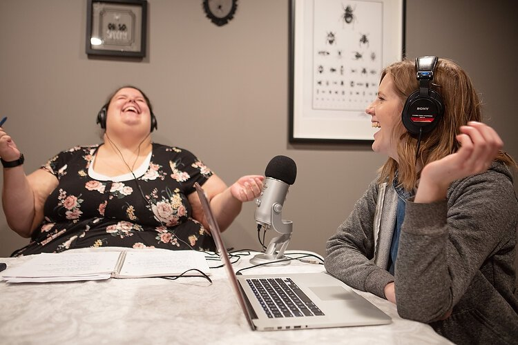 Cate Reed, left, and Jen Vos record This Podcast is Haunted.