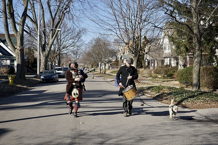 Jesse on bagpipes and his pal on the drum parade the streets of Eastown bringing joy to homebound neighbors.