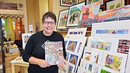 Artist Carolyn Stich in her downtown Holland shop.