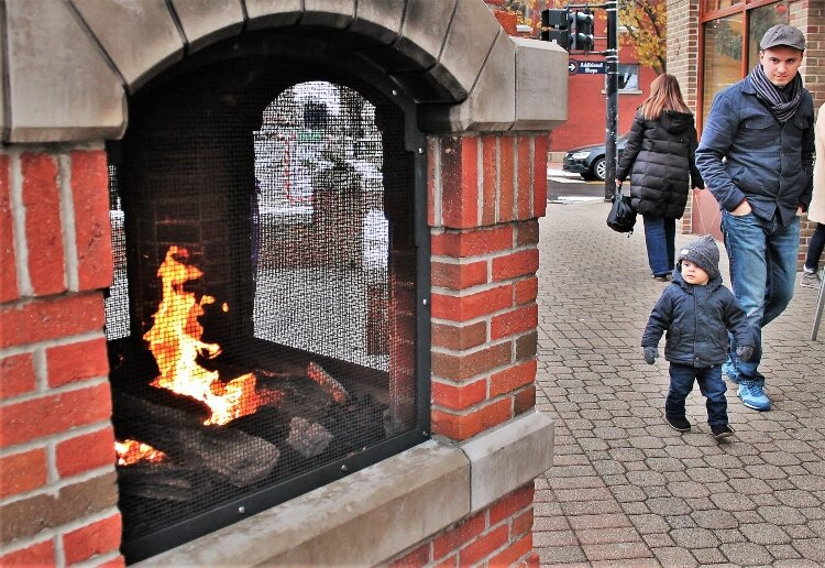 Downtown Holland's fireplace is a favorite place to warm up on a chilly day.
