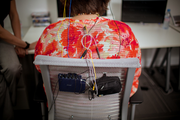 Lead Technician Emily Quinn connects Deborah Johnson Wood to the computer for biofeedback