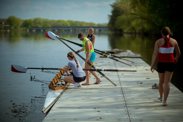 Students get into a shell on the Grand River to practice rowing.
