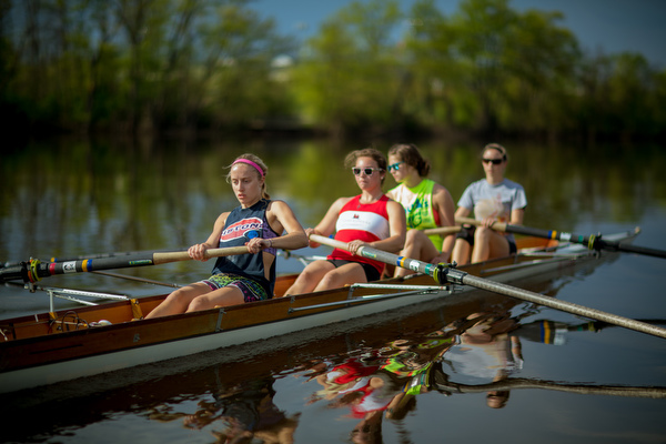 Students row on the Grand River.