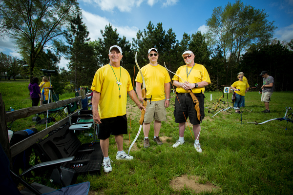 Volunteers manage the shooting range, and monitor safety.