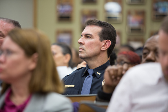 New police chief David Rahinsky listens during a city commission meeting.