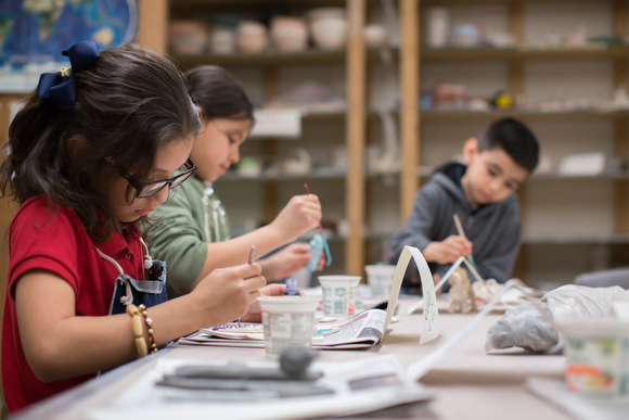 Deisy Cano paints pottery during an art class.