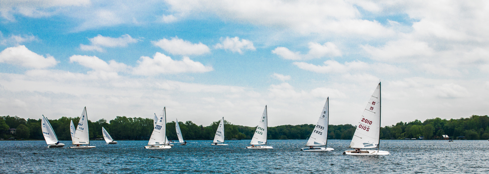 Sail boat racing on Reeds Lake.