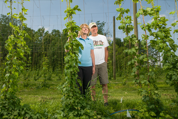 Mary and Morrie Dieleman at their hops farm in Coopsersville.