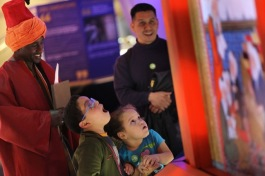 "Kids in awe at a display in ""1001 Inventions"""