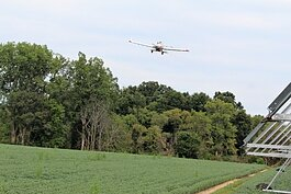 Crop dusting planes maneuver to avoid electric lines, irrigation towers, woods and more when working. (Photo by Bev Berens)