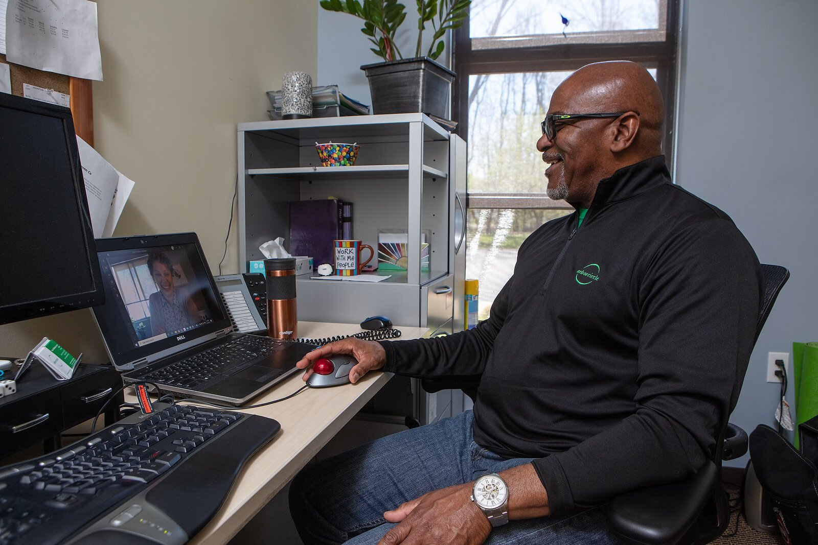 Arbor Circle therapist Marvin Mckenzie simulates a telehealth visit with a colleague.