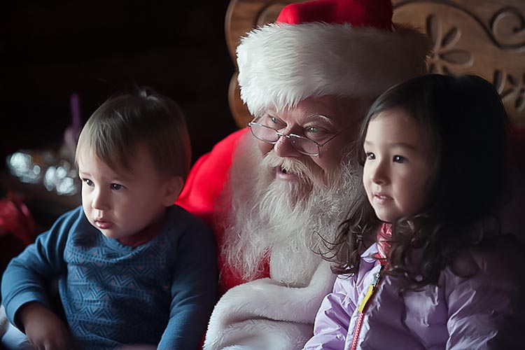 A moment with Santa at Peacock Family Farm. Photo by David Trumpie