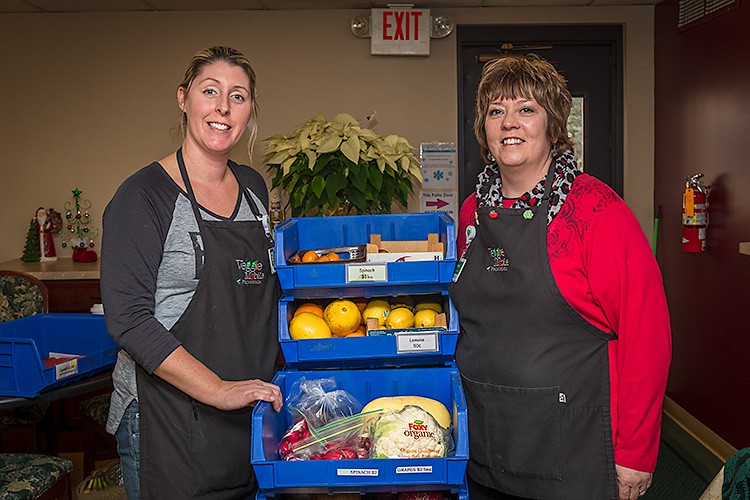 Sara Gould and Stacey Tilton with produce from the Veggie Mobile.