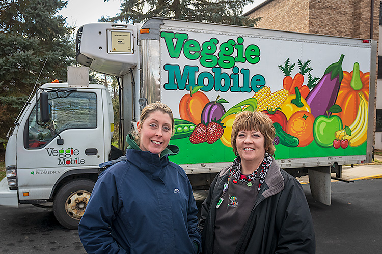 Sara Gould and Stacey Tilton with the Veggie Mobile.
