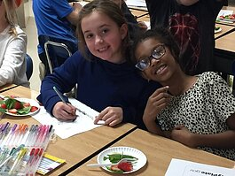 Students taste strawberry and spinach salad in a SPLASH/Nutrition program at Hughes Elementary in Marshall.