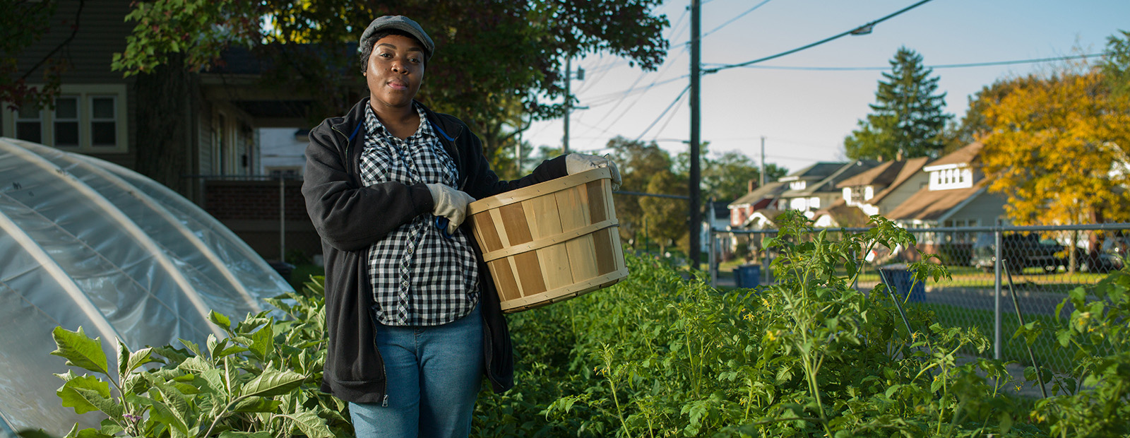 Takidia Smith with Fresh Beets harvests from her urban acreage. <span class='image-credits'>Adam Bird</span>