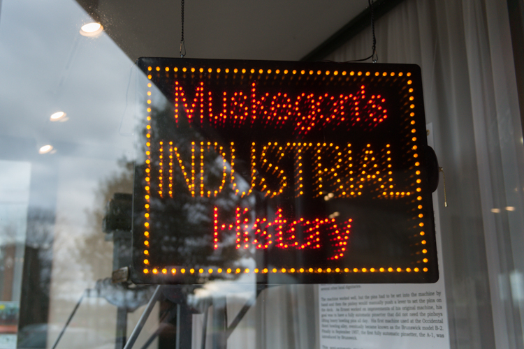 This neon sign hangs in the museum's window.